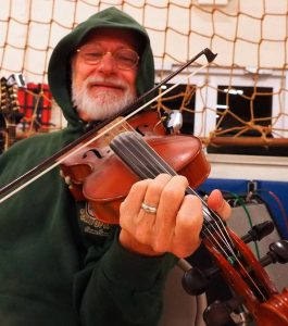 Bo Frazer plays the fiddle